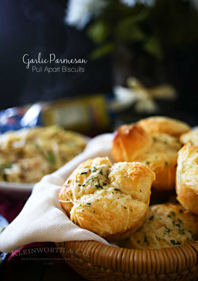 Garlic Parmesan Pull Apart Biscuits - loaded with homemade Italian Garlic Butter & Parmesan cheese. Ready in 20 minutes. Don't miss the recipe for the butter too! It's AMAZING on everything.