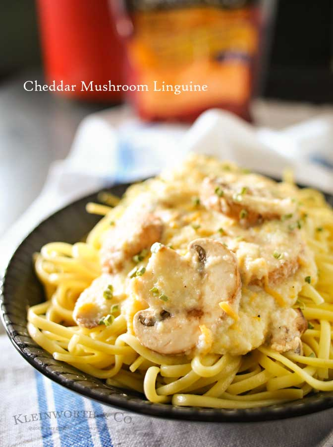 Easy family dinner ideas got better with creamy cauliflower & leek sauce, buttery garlic mushrooms & cheddar cheese on linguine to make Cheddar Mushroom Linguine.