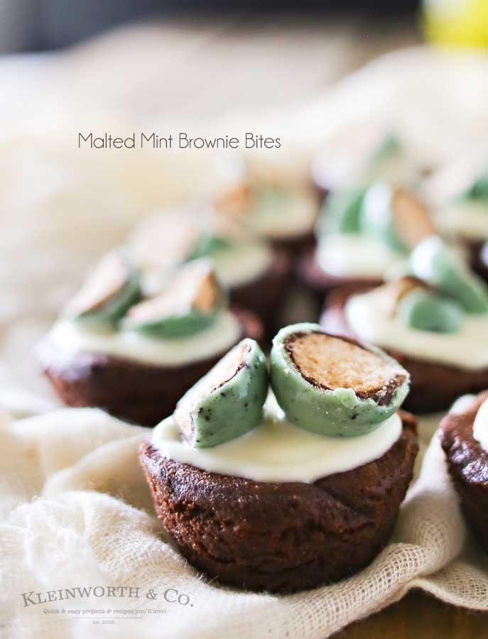 Mint & chocolate lovers rejoice. If you crave that delectable mint & chocolate combo, then this is your lucky day. Thick & fudgy brownie bites topped with white chocolate & mint malt balls makes these Malted Mint Brownie Bites that are out of this world fantastic. YUM! Plus don't miss my trick for making these in under 15 minutes.