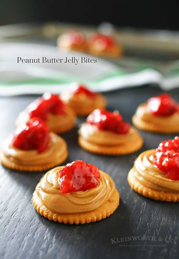 Creamy peanut butter, sweet strawberry jelly & Ritz crackers make Peanut Butter Jelly Bites that are an easy to make snack or appetizer. Salty sweet YUM!