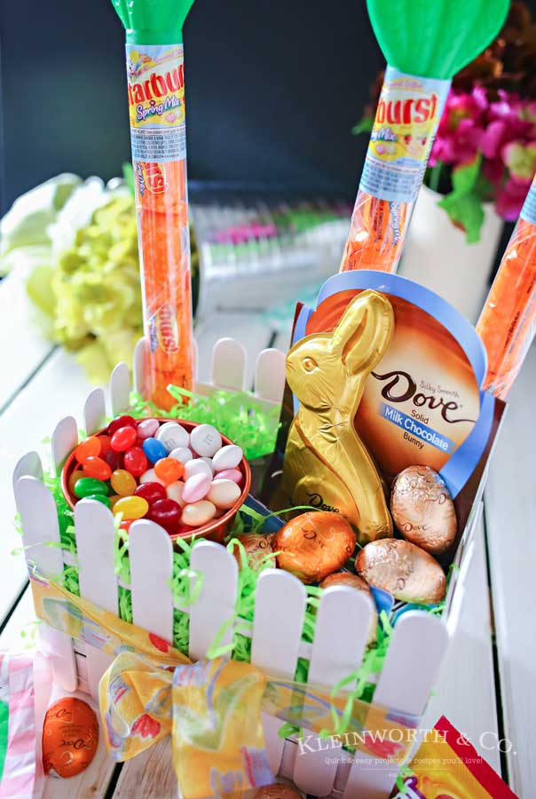 This adorable Picket Fence Easter Basket is easy to make with this step-by-step tutorial using tongue depressors or popsicle sticks. Load it full of your favorite Easter candy & you know everyone will love it. It's definitely my favorite Easter craft! Makes for a great display in an entryway for all your Easter party guests or even to decorate at your office. You won't believe just how quickly you can make your own!