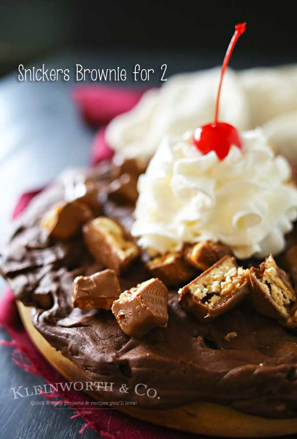 Snickers Brownie for 2, the perfect Valentine's Day treat. Thin brownie layer loaded with Snickers bar pieces & topped with whipped cream and cherry! YUM!