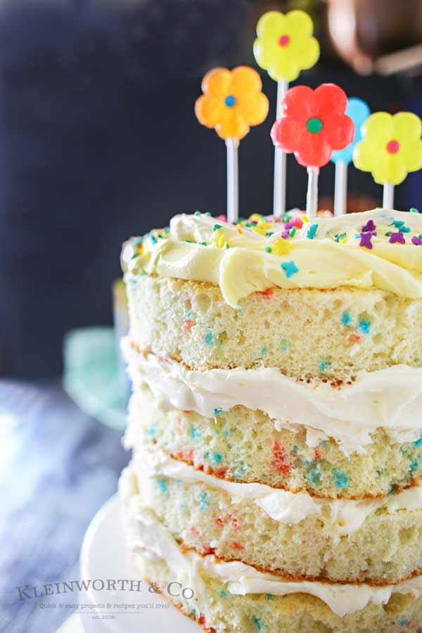"Spring celebrations are fun & easy with this Spring Funfetti® Cake. You can create fun family moments with this cake recipe as one of your Easter desserts. Using frosting just in-between layers for that ""naked cake"" look that is SO popular right now. It's gives the perfect amount of cake to frosting ratio & it's absolutely delicious! I'm loving it for all our holiday & spring birthday celebrations."