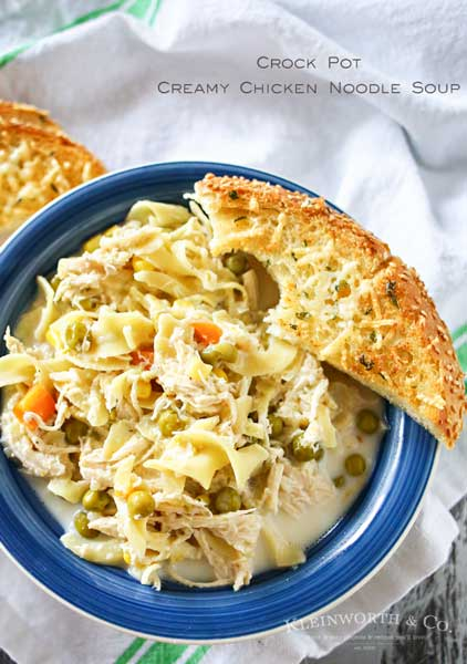 Easy family dinner ideas like this simple crock pot Creamy Chicken Noodle Soup quickly becomes a dinnertime favorite. Just toss it all in the slow cooker & dinner is done with little effort. But oh man is it delicious! Absolutely the perfect easy chicken recipe! Don't miss my tips for speeding up the prep process too!