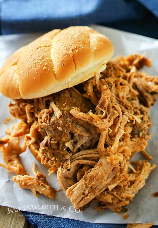 """What's better than an easy slow cooker pork recipe? One that adds the deep flavor of Guinness for a Guinness Pulled Pork. A delicious easy family dinner that is perfect for this time of year right before St. Patrick's Day. But really, it's great all year long. I think this may be my new """"go-to"""" pulled pork recipe! Oh & the sauce - It's AMAZING!"""