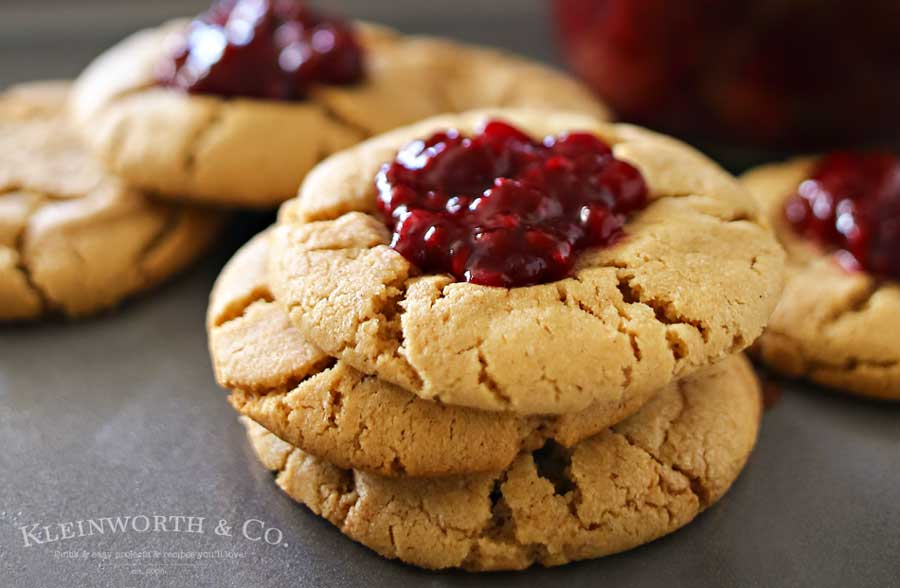 Peanut Butter & Jelly Cookies are a soft & chewy peanut butter cookie recipe topped with a dollop of blackberry preserves. Even better when you make your own jam to add on top. Easy dessert & a PB&J lovers dream! Don't miss my favorite jam recipes I share at the end too. So good!