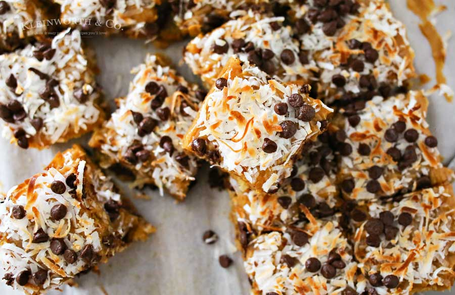 Caramel Coconut Blondies, a yummy bar recipe loaded with butterscotch & chocolate & topped with a layer of caramel, toasted coconut & more chocolate chips.