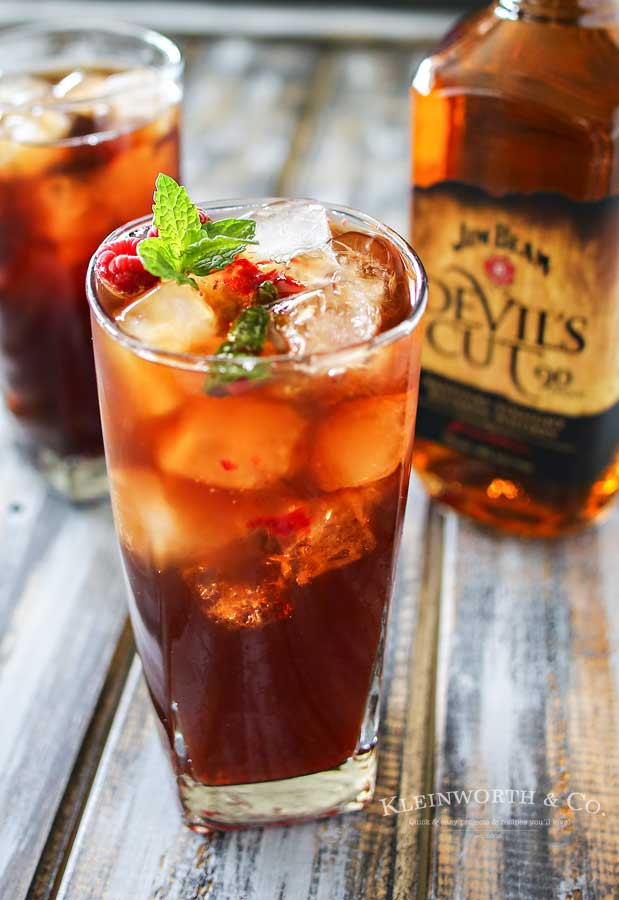 Raspberry Mint HARD Iced Tea is a refreshing summer drink recipe, perfect for a hot day. Fresh raspberries, mint & a little lemon makes this tea perfect.