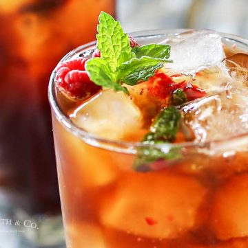 Raspberry Mint Iced Tea is a refreshing summer drink recipe, perfect for a hot day. Fresh raspberries, mint & a little lemon makes this tea perfect.