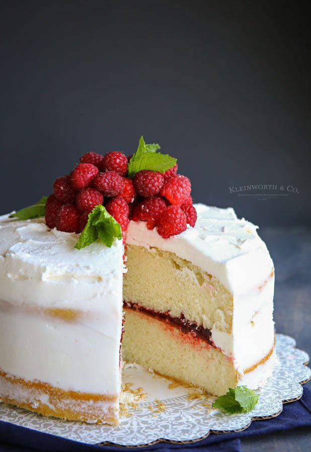 Best Bakery Buttercream Frosting on white cake with raspberry filling