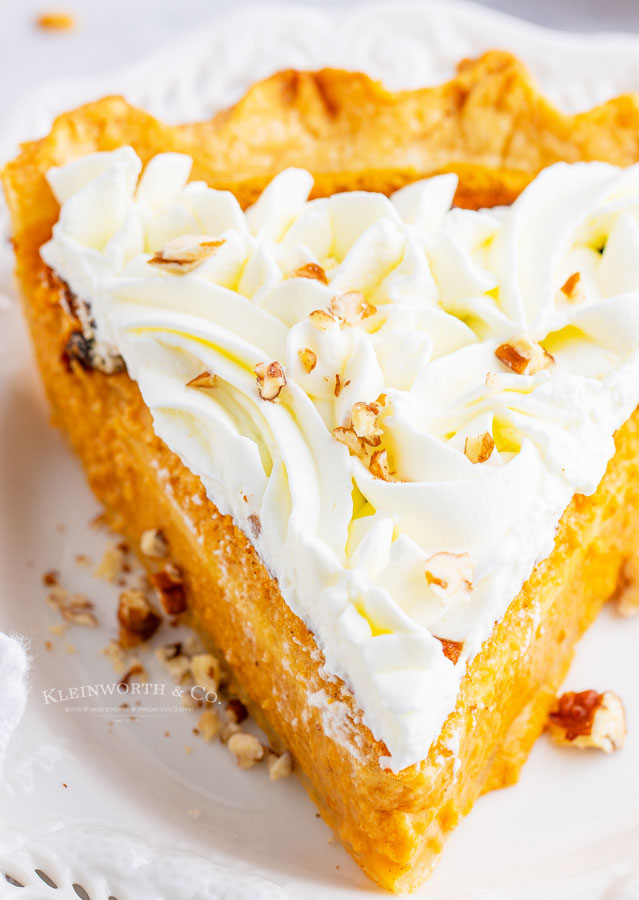 pumpkin pie with decorated whipped cream