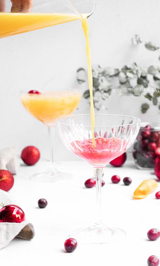 adding orange juice - mimosa