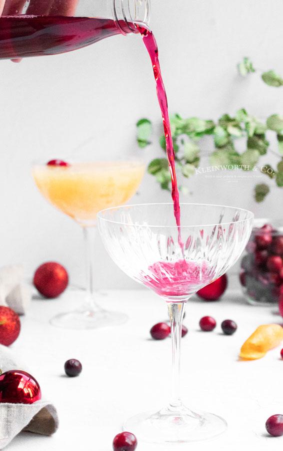 adding cranberry juice mimosa