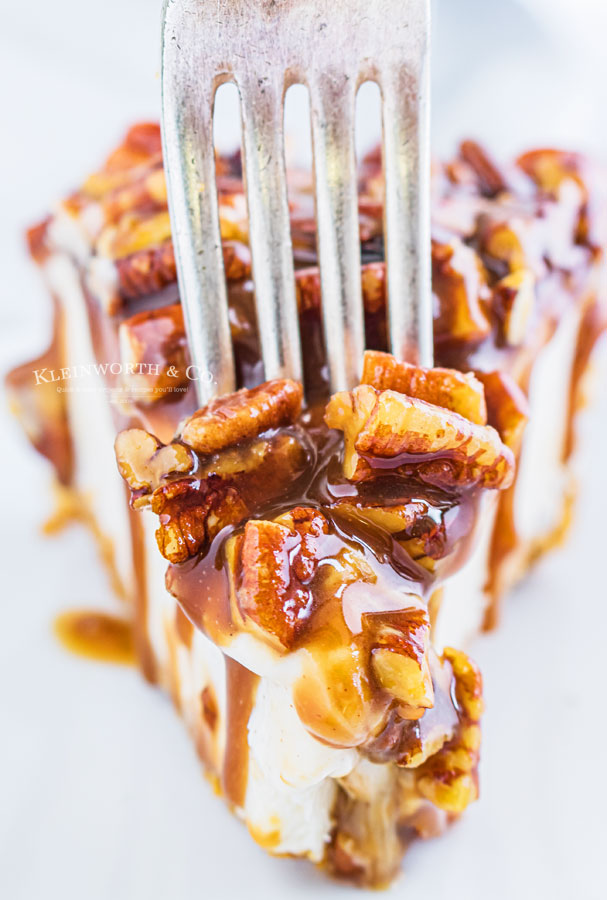 pecan cheesecake with a fork