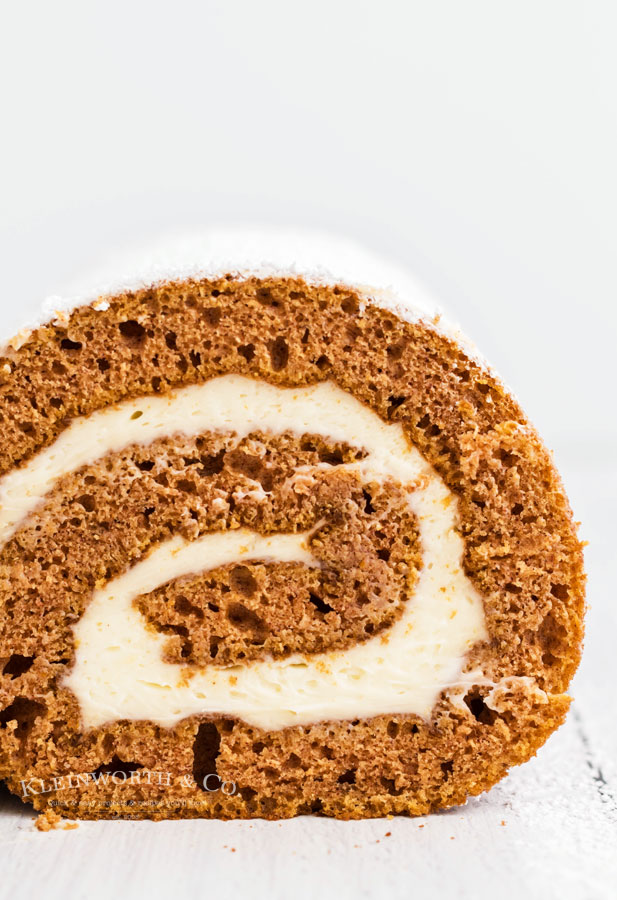 bourbon caramel frosting in a pumpkin roll cake