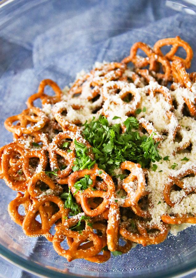 mixing seasoned pretzels