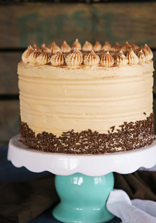 coffee flavored birthday cake on cake stand