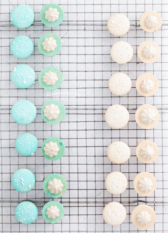 adding filling vanilla macarons
