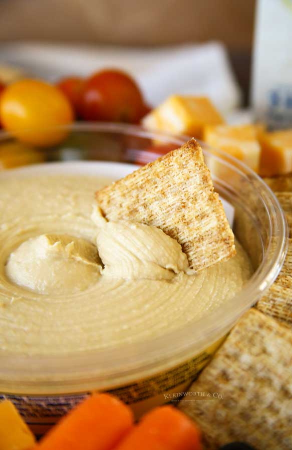 cracker in hummus dip