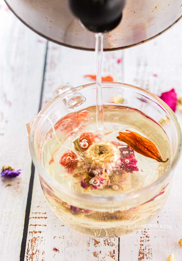 pouring floral tea