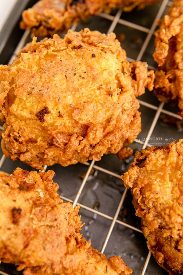 cooked chicken on drying rack